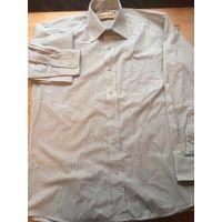 Стильная мужская рубашка Hallmark на 44-46 размер, 39 см горло. Красивый серый цвет в черную тонкую полоску. Длина 75 см, длина рукава 59 см, ПОгруди 54 см. Б/у в хорошем состоянии.