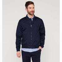Скидка 50% !!! Фирменная высококачественная куртка ветровка .  Куплена и произведена в Европе.Насыщенный синий цвет