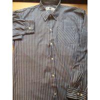 Рубашка мужская на 44-46 размер сине-серого цвета в белую полоску. Длина 87 см, длина рукава 63 см, ПОгруди 56 см. Отличная рубашка, стильной расцветки. Самая нижняя пуговица сломана наполовину, можно