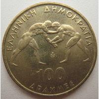 Греция 100 драхм 1999 г. 45-ый Чемпионат по греко-римской борьбе в Афинах