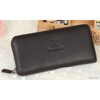 Кожаный кошелёк Mexican, натуральная кожа. Имеет 2 отделения для купюр и 8 карманов для дисконтных, кредитных или визитных карточек, + ещё один из карманов на молнии и предназначен для монет.Цв.чёрный