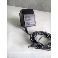 Сетевой адаптер (блок питания) 220 Вольт, 12 вольт = 100 мА. От телефона Панасоник.