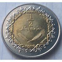 Ливия 1/2 динара, 2004    ( 7-5-3 )