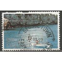 Кайманы. Рыболов на лодке. 1991г. Mi#656.