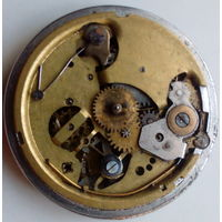 Механизм старых карманных часов на реставрацию.