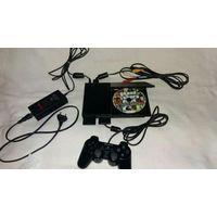 PlayStation 2 и камера EyeToy для неё.