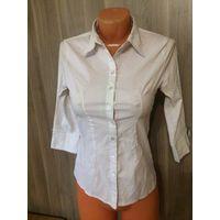 Белая рубашка на девочку 40 размер, длина рукава  см, ПОгруди 41 см, длина 61 см, ПОталии 35 см. Хорошее состояние.    Посмотреть можно в районе ст. метро Фрунзенская. Обмен не интересует. Почтой отпр