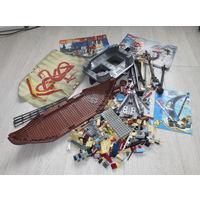 ЛЕГО и только ЛЕГО... более 600 элементов... основы кораблей, мачты, парус и др... старался что бы ничего кроме ЛЕГО не попалось, в подарок описания Lego прилагаются...
