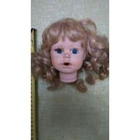 Голова от большой фарфоровой куклы