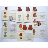 Колодки в сборе с лентами и промзвеньями к медалям + удостоверения к ним. Отличного состояния. Родной сбор!