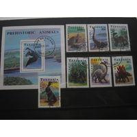Марки - Фауна Танзания. #854-60+БЛ 146. Доисторические животные. Динозавры блок и 7 марок