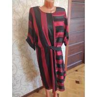Стильное платье на 64-66 размер, идеальное состояние. Очень хорошо смотрится на фигуре, современно и красиво. Платье прямого фасона, талия регулируется поясом, сзади замок, на подкладке, подкладка тян