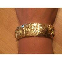 Стильный красивый дорогой браслет, цвет светлое золото, ширина 2.5 см. Покупала для себя выбирала. Ни разу не надела. Обмен не интересует.