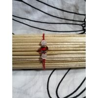 Красный браслет-оберег с красной гранёной бусиной