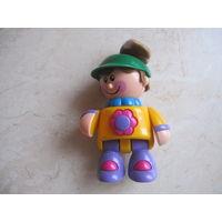 Куколка пластмассовая типа погремушки