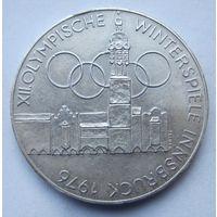 Австрия 100 шиллингов 1975 XII зимние Олимпийские Игры, Инсбрук 1976 - Здания и Олимпийская эмблема (отметка монетного двора Щит - Вена)