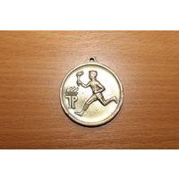Бронзовая, спортивная медаль, времён ГДР, диаметр 5 см.